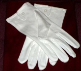 White cotton gloves, good grade make, mother of pearl button and tri stitched back.